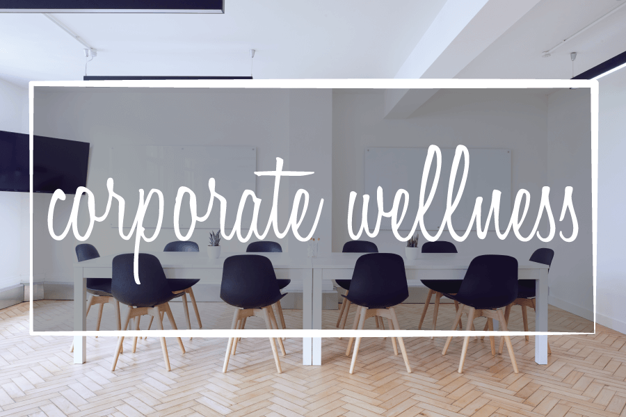 image says: corporate wellness over an image of a meeting room with tables and chairs